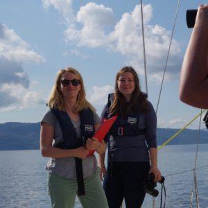 Crew aboard survey vessel preparing data sheets